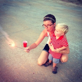 Our first fireworks experience...supervised by mom since she is the health care pro.