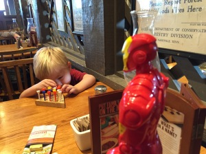 Poor Iron Man...Ian switched to the game. Before breakfast is over, he'll switch back.